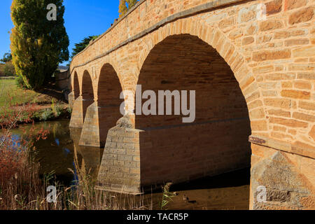 The sandstone Richmond Bridge in Tasmania was built in 1823 and is the oldest stone span bridge in Australia.   It was built with convict labour. - Stock Photo
