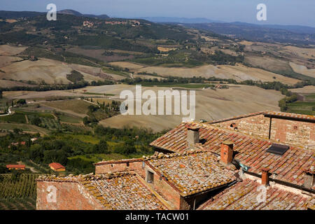 Long view over the rooftops of Montepulciano, Tuscany, Italy, to the Val d'Orcia: from the tower of the Palazzo Comunale - Stock Photo