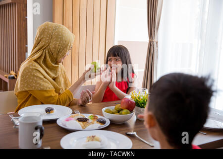 daughter refuse to eat apple - Stock Photo
