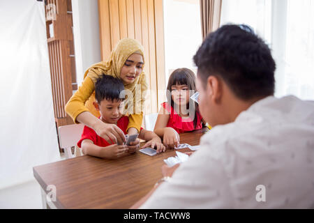kids play card game together - Stock Photo