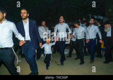 Haifa, Israel - May 22, 2019: Ultra-orthodox Jews dance, as part of the Lag BaOmer holiday tradition, in Haifa, Israel - Stock Photo