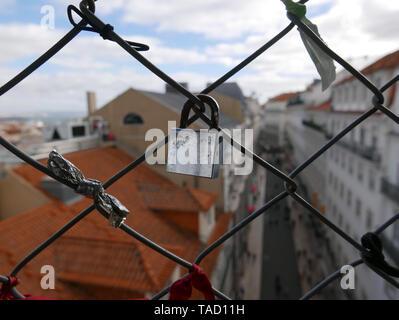 Padlocks on ancient Elevator Santa Justa in Lisbon, Love locks are a symbol of love and commitment - Stock Photo