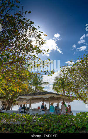Cotton House Resort and Beach and Gardens on Mustique Island. Includes Lily Pond, Beach bar and Beach. The water is Azure blue and the sand is white. - Stock Photo