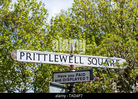 Prittlewell Square street sign signpost, road sign sign post in Southend on Sea, Essex, UK. With trees and have you paid and displayed car park sign - Stock Photo