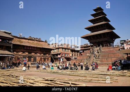 Bamboo scaffolding is piled in Taumadhi Tol, flanked by Newari buildings and the five-tiered Nyatapola pagoda temple, Bhaktapur, Kathmandu Valley, Nep - Stock Photo