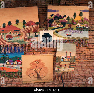 Woven and embroidered wall hangings for sale near Durbar Square, Bhaktapur, Kathmandu Valley, Nepal - Stock Photo