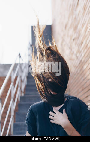 Spain, hair covering face of teenage girl