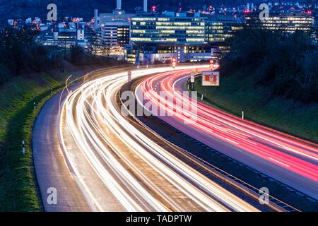 Germany, Badenwurttemberg, Light trails on federal highway near Unterturkheim - Stock Photo