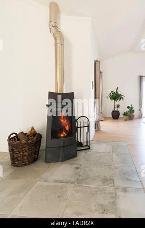 Modern cozy living room with fireplace - Stock Photo