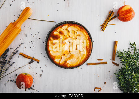 Home-baked apple pie in pan - Stock Photo