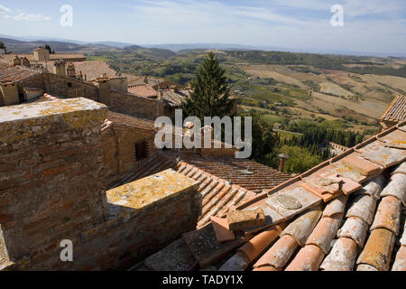 Long view over the rooftops of Montepulciano, Tuscany, Italy to the Val d'Orcia: from the tower of the Palazzo Comunale - Stock Photo