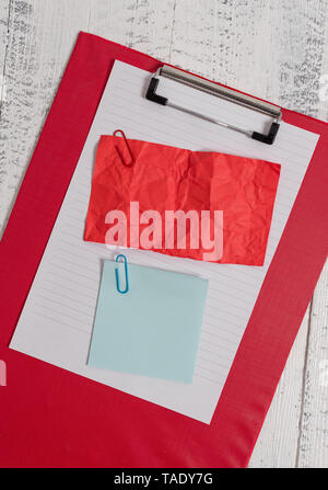 Clipboard paper sheet crushed sticky note clip wooden vintage background - Stock Photo