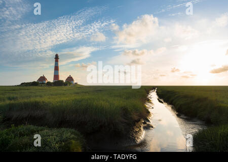 Germany, Westerhever, lighthouse in sunset - Stock Photo