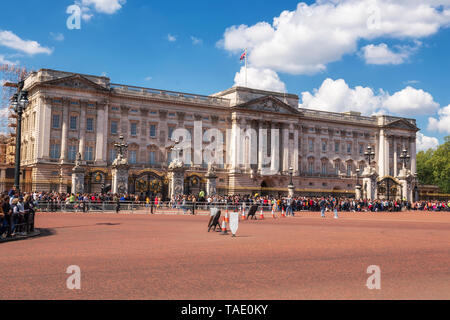 London, United Kingdom - May 12, 2019: : Crowds gather outside Buckingham Palace to watch the changing of the guard ceremony . - Stock Photo