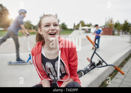 Portrait of happy teenage girl at a skatepark - Stock Photo