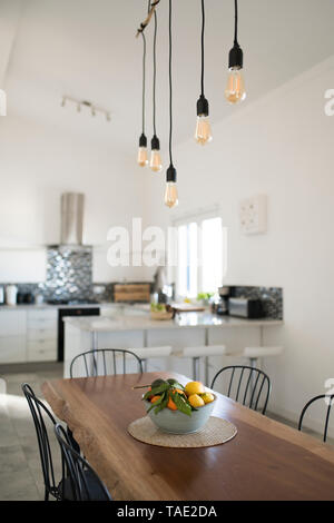 Modern kitchen with wooden table - Stock Photo