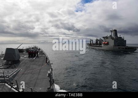 190517-N-JG119-1056   GULF OF ALASKA (May 17, 2019) The Arleigh Burke-class guided-missile destroyer USS John Finn (DDG 113) approaches the Military Sealift Command fleet replenishment oiler USNS Henry J. Kaiser (T-AO 187) during a replenishment-at-sea while participating in Exercise Northern Edge 2019. Northern Edge is one in a series of U.S. Indo-Pacific Command exercises in 2019 that prepares joint forces to respond to crisis in the Indo-Pacific region. (U.S. Navy photo by Mass Communication Specialist 3rd Class Janine F. Jones/Released) - Stock Photo
