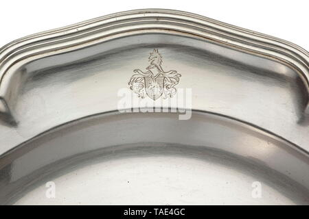 A silver plate formerly owned by Count Zeppelin (1883 - 1917) Crafted by the jeweller to the court Foehr in Stuttgart. Banded edge with relief decoration, on the border the coat of arms of the von Zeppelin family. The jeweller's mark 'Foehr' and mark of fineness '800' stamped into the base. Diameter 24 cm. Weight 500 g. historic, historical, troop, troops, armed forces, military, militaria, army, wing, group, air force, air forces, 20th century, Editorial-Use-Only - Stock Photo