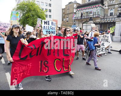 London, UK. 24th May, 2019. Students from Kings College London march for action on climate change along the Strand to meet up with the main protest event. Credit: Alan Gallery. - Stock Photo