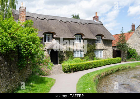 The iconic Chocolate Box Thatched Cottage in Thornton le Dale in the North York Moors National Park