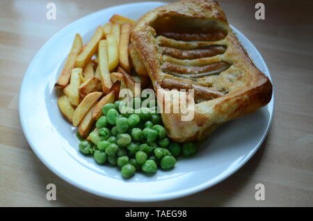 home cooked sunday lunch, toad in the hole - Stock Photo