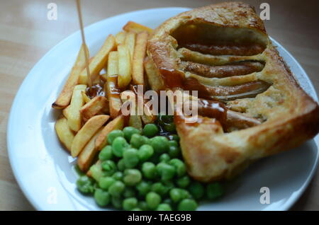 home cooked toad in the hole - Stock Photo