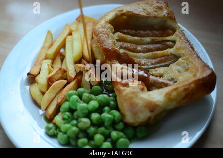 Home cooked Toad in the hole (sausages baked in batter, England) - Stock Photo