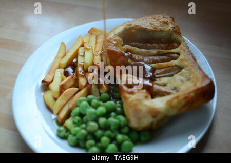 Home cooked Sausage Toad, Traditional British 'Toad in the Hole' meal - Stock Photo