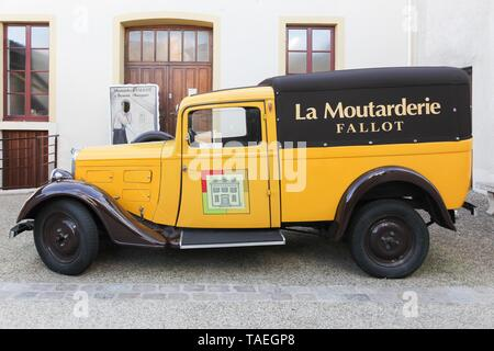 Beaune, France - October 6, 2017: Fallot Mustard vintage car at the boutique in Beaune. - Stock Photo