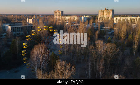 Drone image taken over the amusement park at Pripyat, Ukraine, inside the Chernobyl Exclusion Zone - Stock Photo