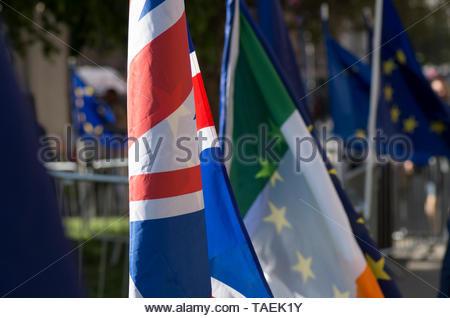 London, UK. 23 April 2019. Union jack, Irish tricolour and the EU flag flutter near parliament on European election day in the UK, Westminster, London.   © Stuart Walden/ Alamy - Stock Photo