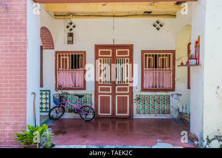Traditional chinese shophouse architecture in George Town Malaysia - Stock Photo