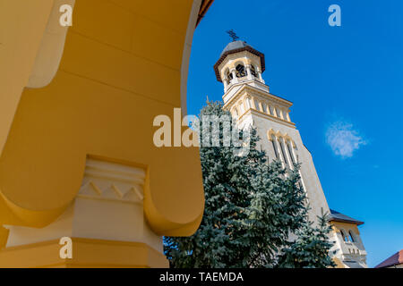 Beautiful view to the Coronation Reunification Cathedral Bell Tower in Alba Iulia city, Romania. A Bell Tower on a sunny day in Alba Iulia, Romania. - Stock Photo