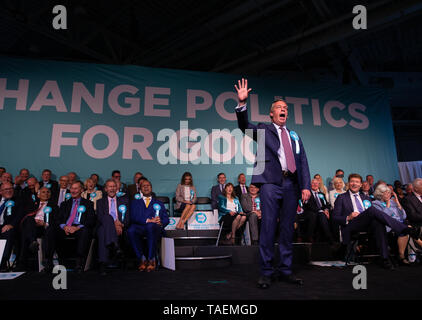 Brexit Party leader, Nigel Farage, speaks at a rally of 3,000 people in Kensington Olympia ahead of the European Elections on May 23rd. - Stock Photo