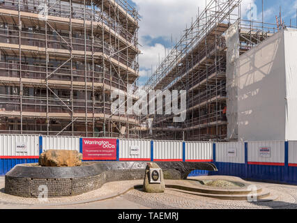 Warrington town centre New market deveopment with Tim Parry, Jonathon Ball statue in foreground. - Stock Photo