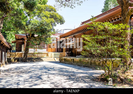 Tokyo, Japan Meiji shrine architecture with green tree foliage at courtyard with nobody on sunny day - Stock Photo