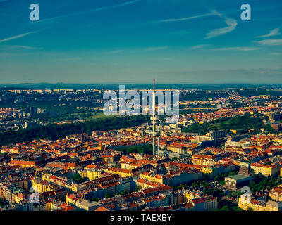 aerial view of zizkov tv tower in prague under bright sky and clouds sunny day - Stock Photo