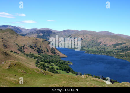 View south west from the summit of Hallin Fell in English Lake District looking across Ullswater towards Helvellyn , Sheffield Pike and other fells. - Stock Photo
