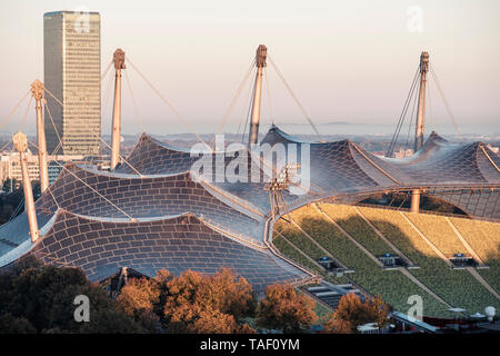 Germany, Munich, Olympic Park, Olympic Stadium, tent roof construction in the morning light - Stock Photo