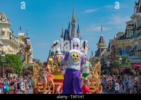 Orlando, Florida. May 16, 2019. Orlando, Florida. April 02, 2019. Mickey and Minnie's Surprise Celebration parade on lightblue sky background at Walt