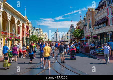Orlando, Florida. May 17, 2019. People walking in Main Stree  on Magic Kingdom at Walt Disney World Resort  (2) - Stock Photo