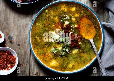 Caldo verde, soup with green cabbage, chorizo and potato - Stock Photo