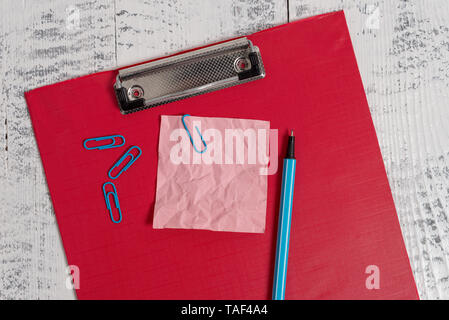 Colored clipboard crushed sticky note clips marker old wooden background - Stock Photo