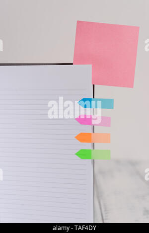 Hard cover note book sticky note arrow banners inserted clear background - Stock Photo