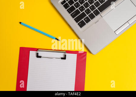 Trendy metallic laptop clipboard paper sheet marker colored background - Stock Photo