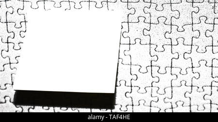 Piece of square note paper use for give notation stick to puzzle background - Stock Photo