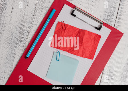 Clipboard paper sheet crushed sticky note clip marker wooden background - Stock Photo