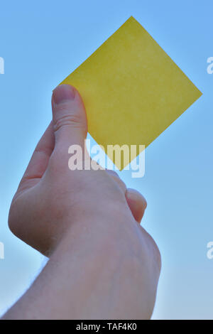 Piece of square paper use to give notation hold by one hand raising up - Stock Photo