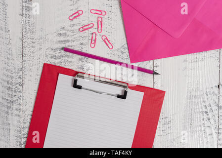 Colored clipboard blank paper sheet pencil envelope clips wooden background - Stock Photo
