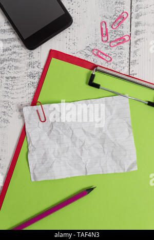 Clipboard paper sheet pencil smartphone note clips wooden retro background - Stock Photo